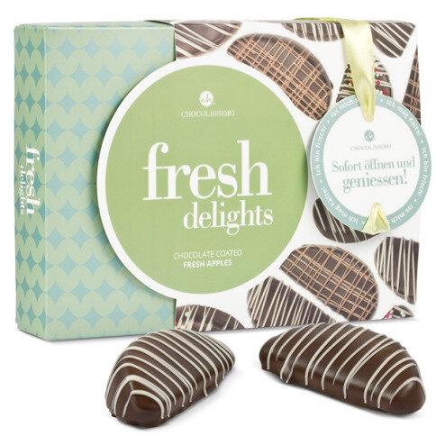 Äpfel in Zartbitterschokolade und weißen Schokolad