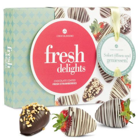 Erdbeeren in drei Schokoladensorten